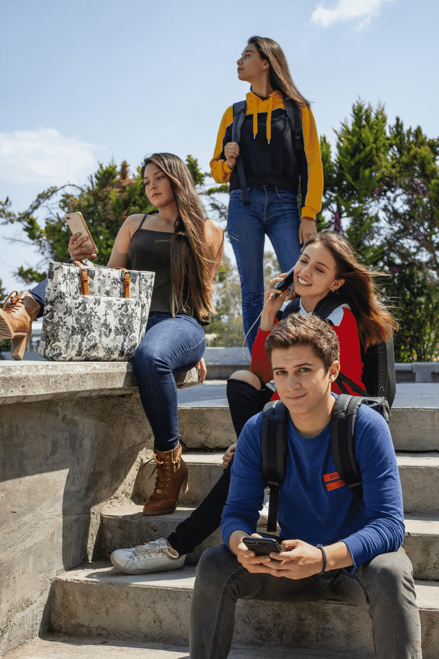 a group of students sitting on the stairs