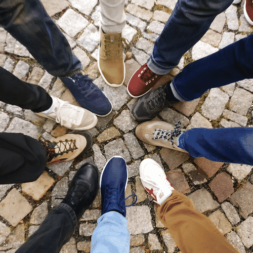 students putting their shoes in a circle