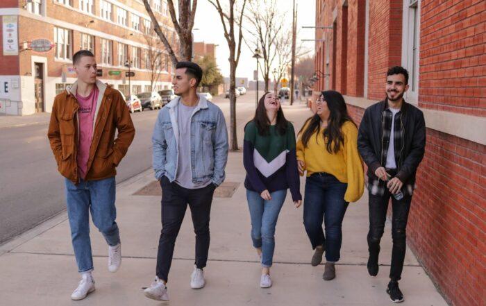 Five teens walking