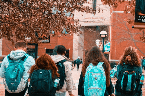 high school students walking into school