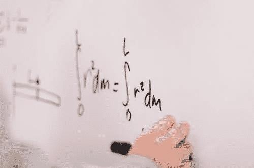 Math equation written on a whiteboard