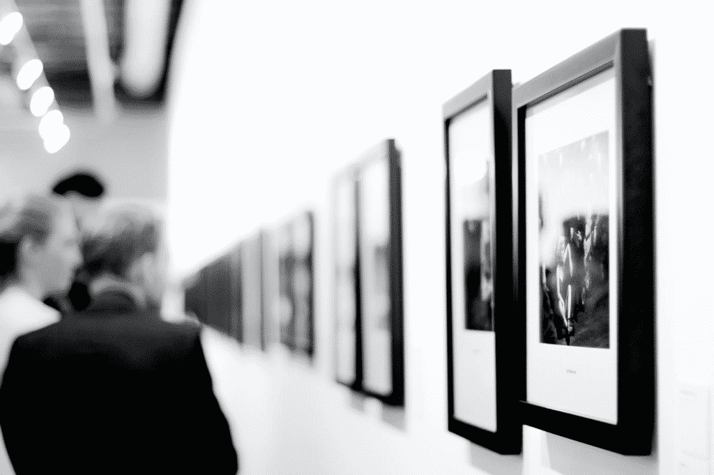 people looking at photographs at a photography exhibition